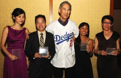 Heidi Chang, pictured 2nd from right, accepts AAJA national award in New York. | Photo © Lia Chang