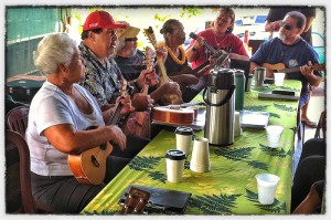 Roy Horner (pictured second from the left) plays ukulele at a jam session open to everyone | Photo © Zack Socher