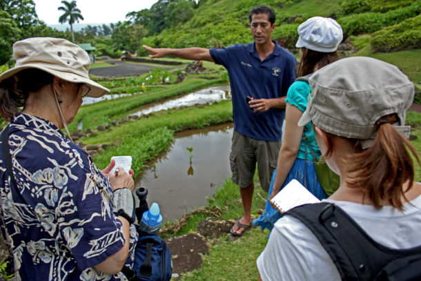 Kawika Winter gives a tour of the garden to a group of environmental journalists. Photo: Courtesy of the National Tropical Botanical Garden