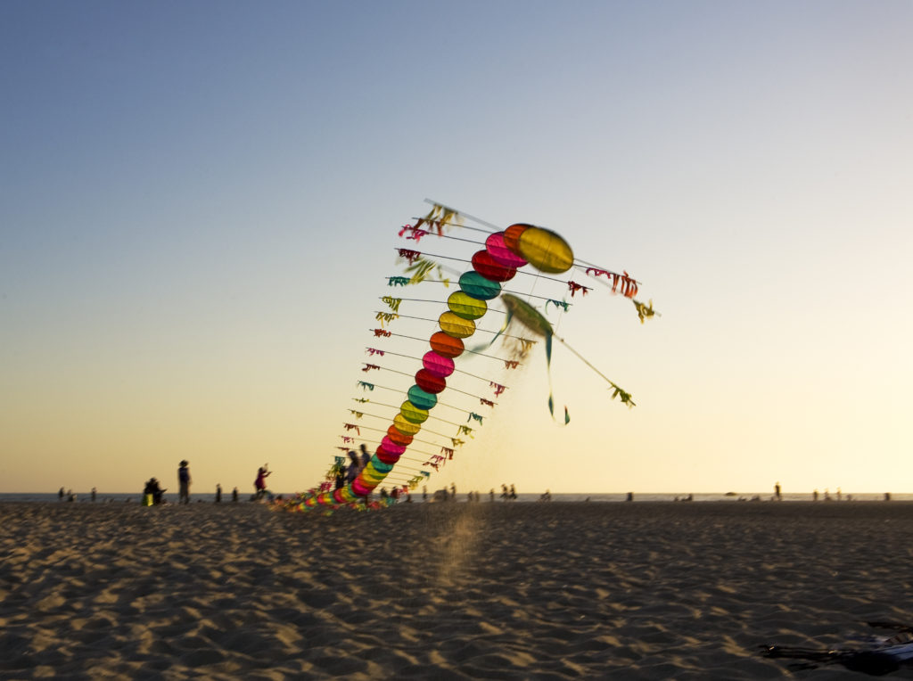 Tyrus Wong's centipede kite begins to rise into the sky above Santa Monica Beach | Photo © Sara Jane Boyers